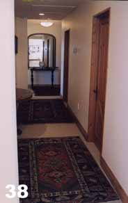 Large Persian rugs on top of a sisal look wool carpet.