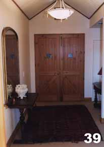 The main entrance with double doors and shuttered peepholes.